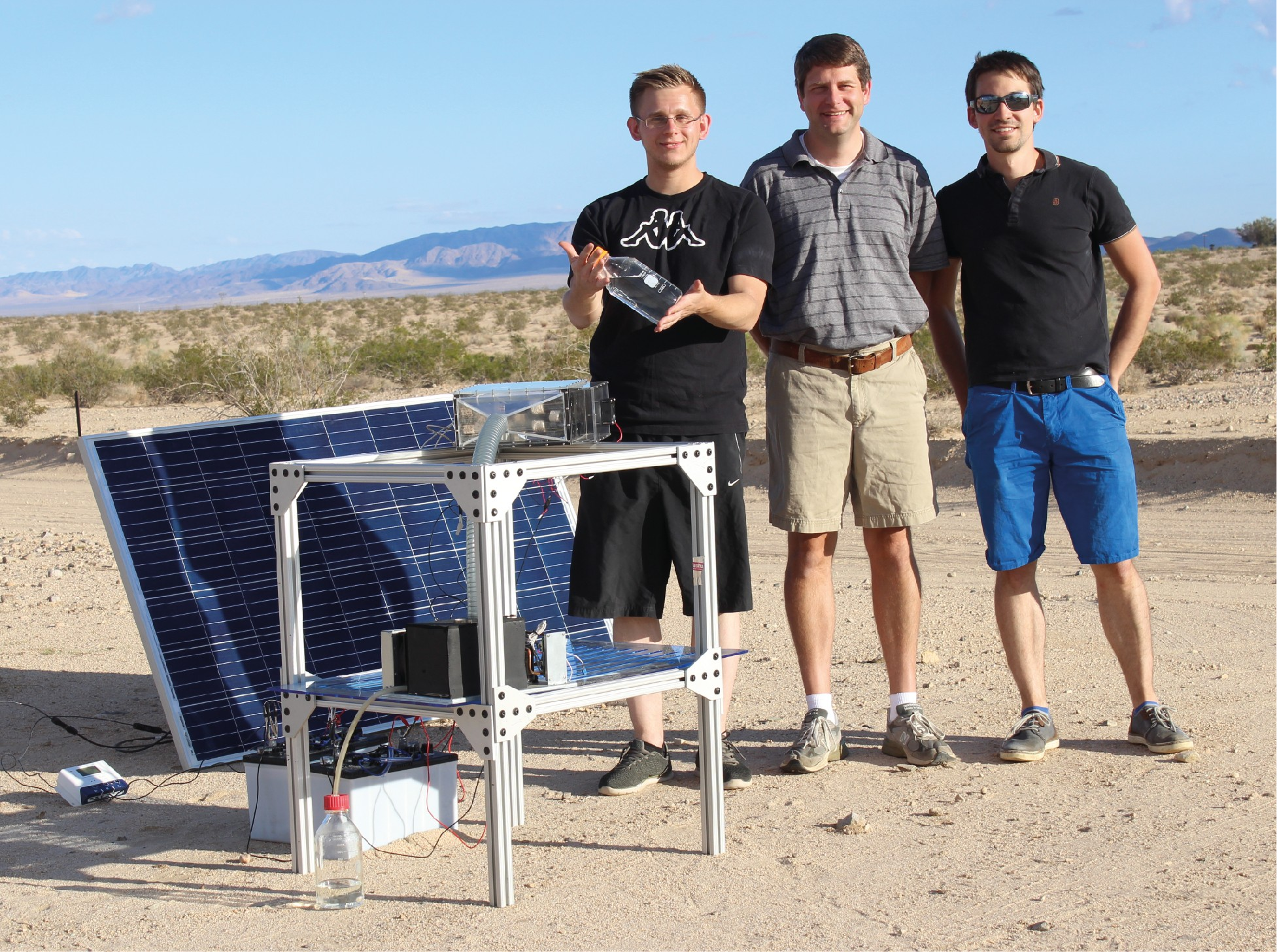 Figure 1: Water harvesting team along with the latest atmospheric, solar-driven MOF-based water harvester.